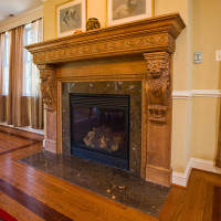 Custom Fireplace and mantle in dining room. Granite surround